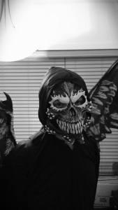 teen in fallen angel costume