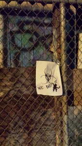 Sign from 12 Monkeys on a fence