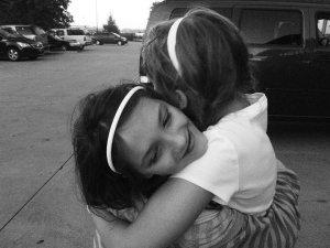 Little girls hugging
