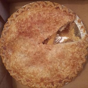 Apple pie with a slice missing
