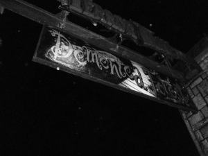 "Black and White ""Demented Forest"" sign"