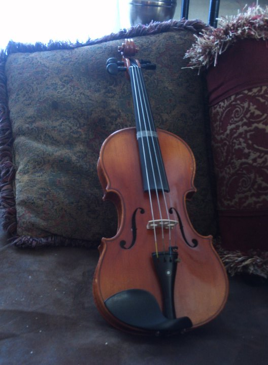 Violin in front of pillows