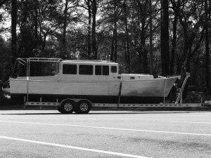 Black and white photo of boat on a trailer