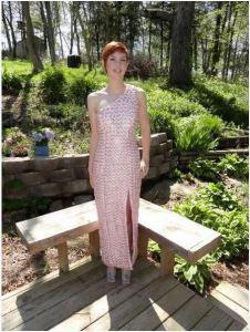 High School student wearing dress made of pull tabs and pink ribbon