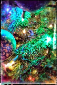 Christmas lights and ornaments on a tree, close up