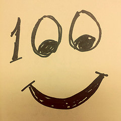 100 with a smiley face