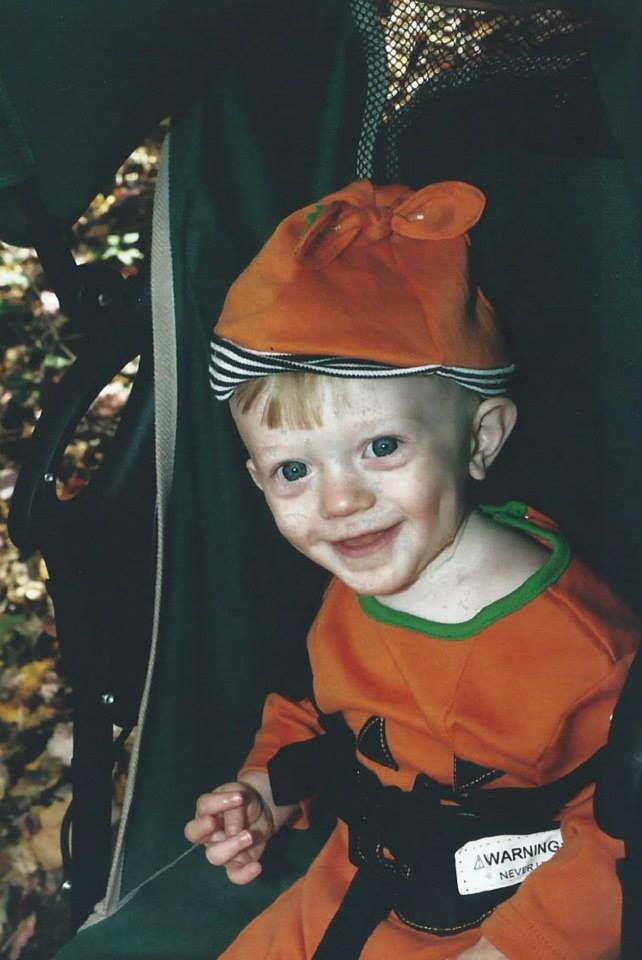 william wearing a pumpkin costume, in a the stroller