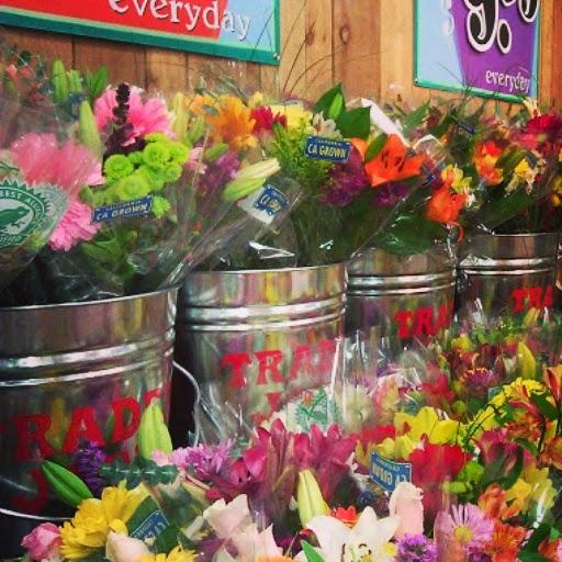 Cut flowers in silver Trader Joe's buckets