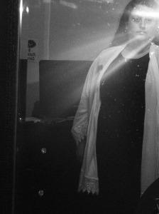 Self-portrait: black dress, white shroudy looking jacket