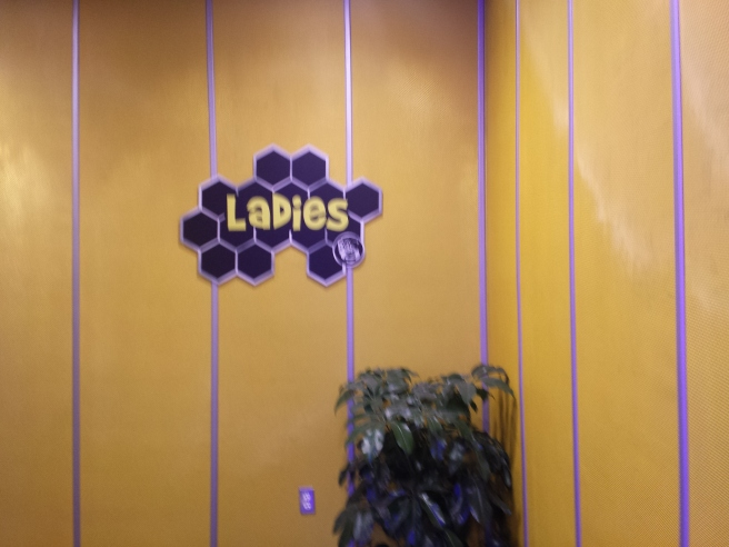 Ladies room sign - shaped like bees wax