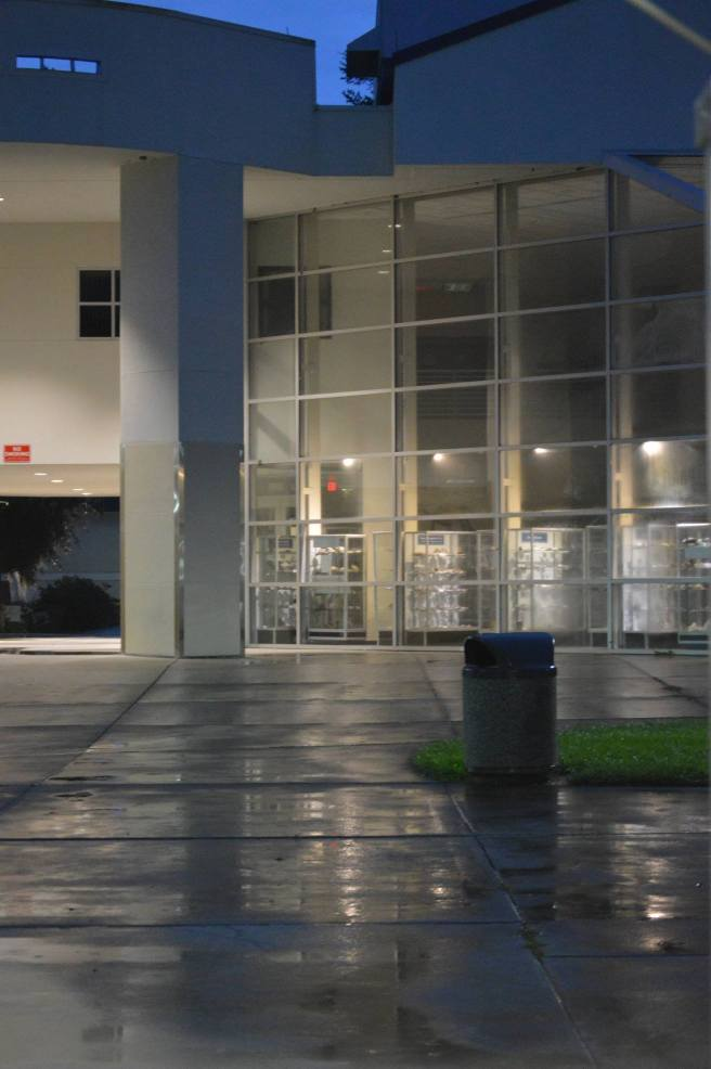Part of Santa Fe College's Natural Science Building at night, after rain.