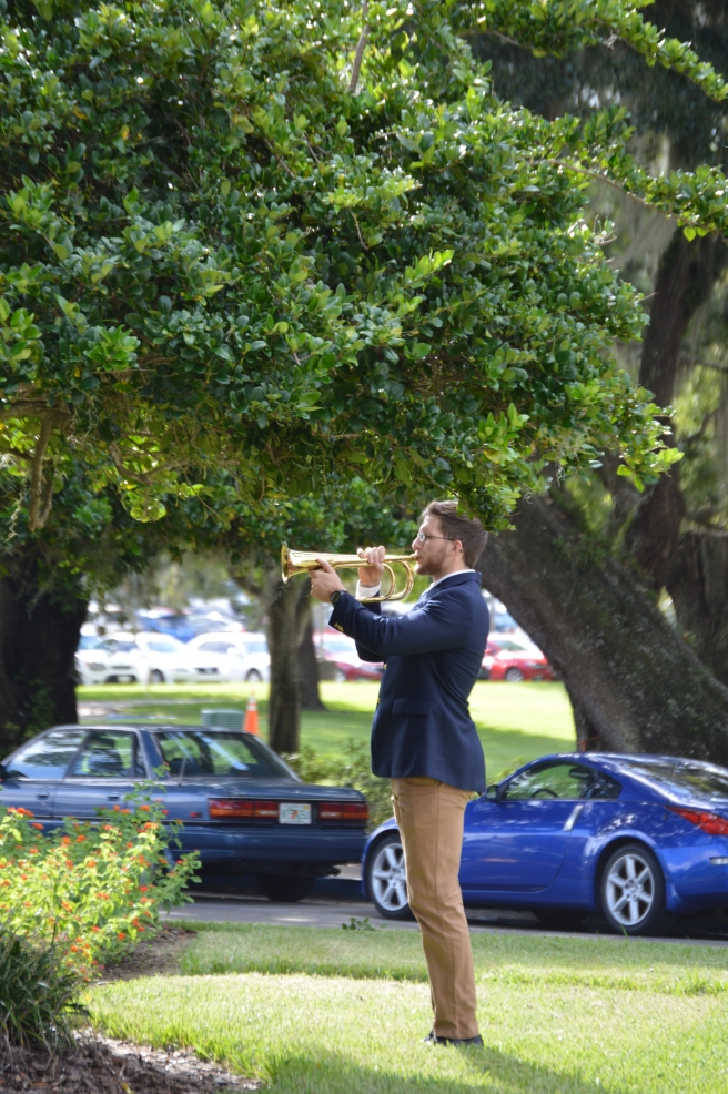 Man with bugle, playing