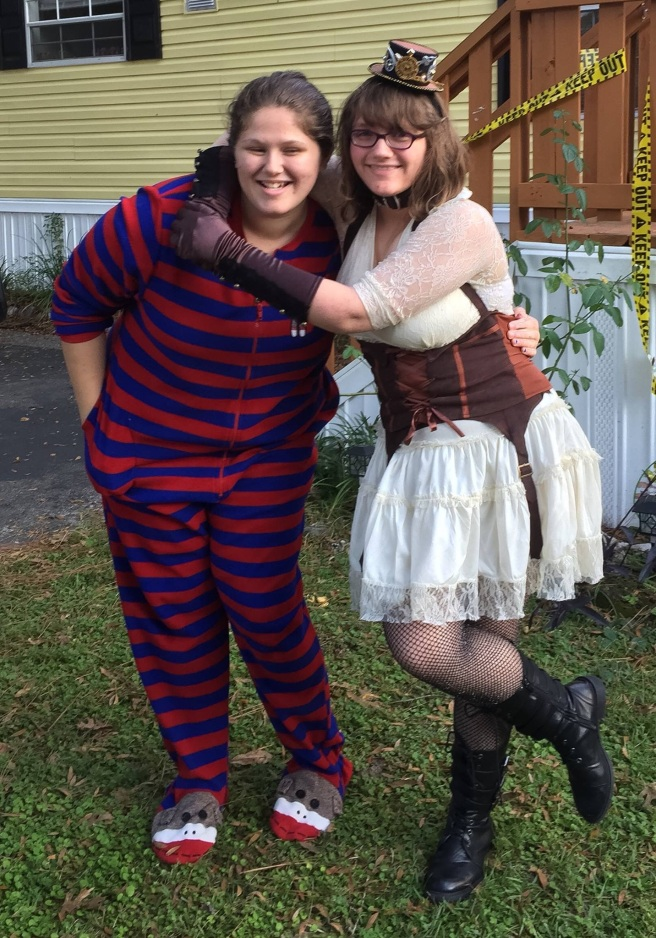 Girl in pajamas and girl in Steampunk costume