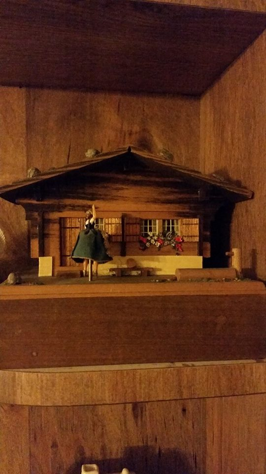 Dancing lady in front of a cottage